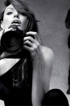 Angelina Jolie photographing herself in Marie Claire.