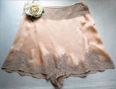 Not only is the design of these French knickers oozing with amazing handmade details...they're in impeccable, pristine, never worn condition...a rare find these days!  Bias cut in a lustrous peach silk crepe de chine, they're beautifully engineered without side, front or back seams giving a smooth, unblemished silhouette.  The side panels are inserted with the tiniest faggotting detail.  These knickers are a step-in style and the crotch and hems are finished all around with a lovel..