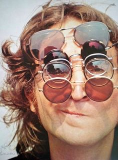 Portrait of John Lennon of The Beatles, wearing a stack of sunglasses. Ringo Starr, George Harrison, Paul Mccartney, John Lennon Sunglasses, Les Beatles, Beatles Quotes, Beatles Poster, Beatles Band, Beatles Songs