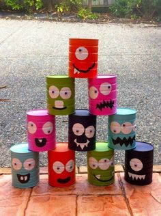 """I painted 10 baby formula cans (they don't have sharp edges). Now it's """"Monster Toss"""" for the party!: Tracey van Lent I painted 10 baby formula cans (they don't have sharp edges). Now it's Monster Toss for the party! Kids Crafts, Tin Can Crafts, Diy And Crafts, Crafts Cheap, Jar Crafts, Formula Can Crafts, Baby Formula Cans, Baby Formula Containers, Monster Birthday Parties"""