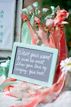Fun wedding recessional idea - pink + teal ribbon wands to wave after ceremony {Happy Confetti Photography}