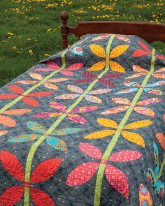 Your brightest, happiest scraps belong in this quilt