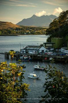 Skye. Portree Harbor and Cuillins. See image for copyright