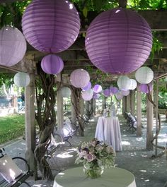 These circular paper lanterns are a unique way to brighten up your wedding space. #purpleweddings #weddingdecor