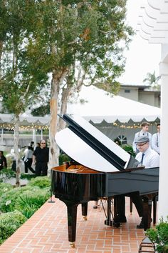 Pianist in Newsboy Cap at Piano | Photography: Luke & Katherine Griffin for Max & Friends. Read More: http://www.insideweddings.com/weddings/tent-wedding-with-chic-nautical-theme-on-la-playa-bay-in-san-diego/737/
