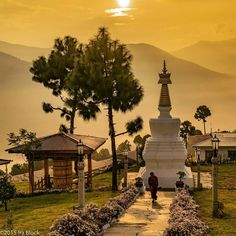 Photo by @irablockphoto (Ira Block)  Sunrise over the Sangchen Dorji Lhendrup Nunnery in Punakha Bhutan. Thus beautiful Buddhist Nunnery is located high above the Punakha Valley. Early morning brings fog and smoke to this central Bhutan region. The smoke comes from farm house stoves and the burning of juniper a traditional Buddhist offering. #Follow me @irablockphoto to see more images from #bhutan. @thephotosociety @natgeocreative #punakha #nunnery #buddhism #temple #stupa #fog #sunrise…