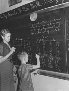 Lois Slinker teaching the only pupil in the second grade in one-room schoolhouse. Grundy County, Iowa. Arthur Rothstein. 1939.