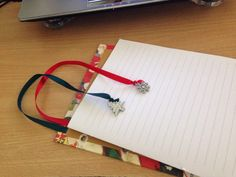 Binding the christmas book. With ribbon & pendant bookmark.