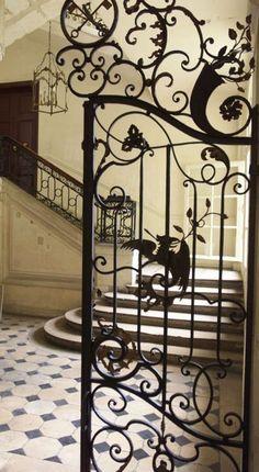 Parisian Apartment | Lovely decorative wrought iron gate in Paris apartment entry. ~