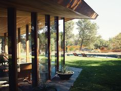 Modern home renovation in Napa includes redwood and glass facade with pool