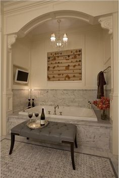 Romantic bath by Michael Abrams Corbels, panel molding, crown molding....