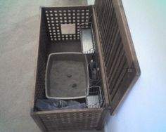 a hol storage box from IKEA. Cut out a section from the side for a concealed litter box that's big enough to hold an extra large litter box, the extra litter and all the extras (poop scoop, litter deodorizer and bags).
