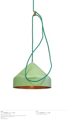 Lloop lamp copper/green, by Ontwerpduo.  The Lloop lamp is adjustable in height by extending or shortening the loops of the electricity cable which come as the result of the wooden pieces.    With this the function becomes the decoration, simple and clear with no hidden techniques.