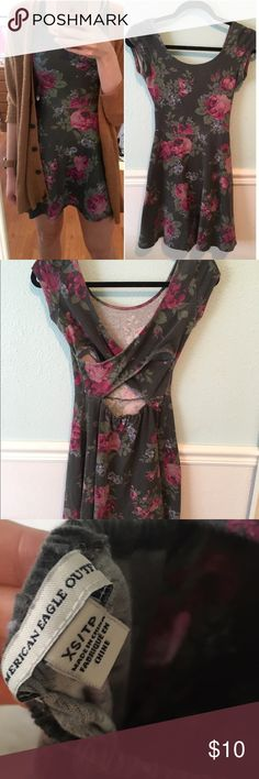 AE Floral Skater Dress Adorable floral skater dress with open cross back! Used but in loved condition! ❤️ a little bit of fading but hardly noticeable. Pair with some tights and boots for an adorable fall outfit American Eagle Outfitters Dresses Mini