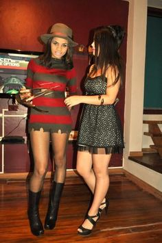 Hot Freddy Krueger Halloween Costume. Black boots. One hand has very long fake finger nails instead of sharp knife nails