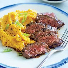 Chipotle Hanger Steak with Sour Cream Mashed Sweet Potatoes | MyRecipes  Hanger steak is a flavor-packed cut of beef is even better when paired with mashed sweet potatoes.