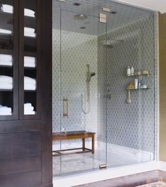 Unique bathroom tiles and bench to sit on in shower