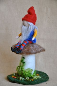 Waldorf inspired needle felted Soft Sculpture : Gnome sitting in his mushroom.