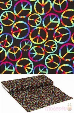 black cotton fabric with tossed peace signs in bright tie dye rainbow colors, suitable as blender fabric, 100% cottom, great quality USA fabric from Timeless Treasures #Cotton #USAFabrics