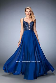 This gorgeous gown features La Femme's high quality lace on the bodice. The plunging neckline is filled with sheer for comfort and coverage. The flowing chiffon skirt would be perfect at prom or on th
