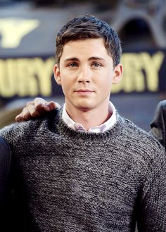 Logan Lerman poses during a photocall for the film 'Fury', on October 18, 2014 in Paris.