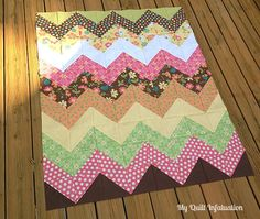 chevron quilt - love the way she makes the squares and cuts four triangle pieces from each one! Makes it so much easier!