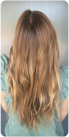 Blondes thinking of going darker and brunettes thinking of going lighter should definitely consider this shade. Light golden brown is a flattering color on nearly every skin tone. Color by Mina Wok...