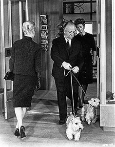 Alfred Hitchcock w/ his sealyham terriers in the opening scene of The Birds