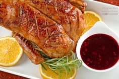 Slow roasted whole duck yields a flavorful, moist bird with a beautiful, crispy skin, and the spiced pomegranate complements it to perfection.