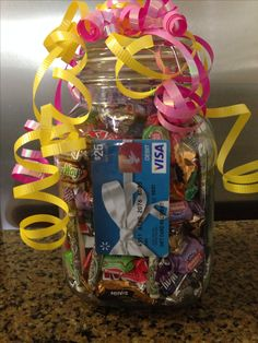 High School Graduation Gift - mason jar filled with $10 in $1s rolled up, candy, bubble gum, gift card & college checklist from the Target website.