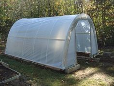 This Hoop-House was built by Door Garden, and was profiled in Birds and Blooms magazine. Lot's of good information here, and step by step photos.