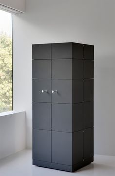 The Cubrick Decanter cabinet - a truly magical british piece by Yard Sale - you have to see the movies on twitter to really get a feel for it: @yardsaleinfo  London Design Festival 2014: Design Junction  Grey, small