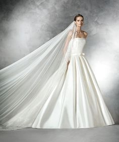 The New Design Princess-style mikado silk wedding dress with dropped waist. Bodice with strapless neckline, decorative bias band at the waist, front and back. Skirt with pleats and side pockets Free Measurement