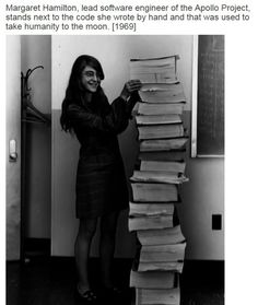 Margaret Hamilton, lead software engineer of the Apollo Project, stands next to the code she wrote by hand and that was used to take humanity to the moon (1969)