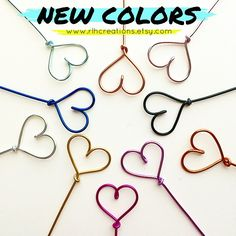 We now offer 10 wire color options! 5 of them are brand new! // www.rlhcreations.etsy.com // #wedding #hangers #rlhcreations #etsy