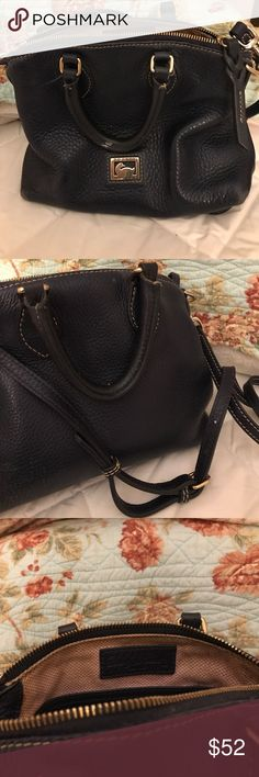 Navy Dooney and Bourke bag Beautiful exterior. Small stain on inside of handle. Removable straps perfect condition. Bottom has wear signs from pencils n pens. Interior back pockets in excellent condition. Mostly floor of interior shows love wear. Gold hardware. Corners beat up on bottom Dooney & Bourke Bags Totes