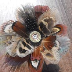 Try this feather brooch — with a bullet centre— on for size. Feather Crafts, Feather Art, Phesant Feathers, Shotgun Shell Crafts, Shotgun Shells, Hunting Crafts, Hunting Wedding, Bullet Jewelry, Country Crafts