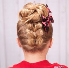 Upsidedown pull through braid to make hearts with a bun. Love this!