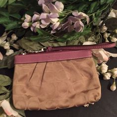 Coach Wristlet Pre loved Coach Wristlet. No tears or rips. Excellent condition. Inside has a slot for ID and it has a zipper to close. Coach Bags Clutches & Wristlets
