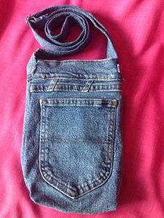 Denim Crossbody purse, two outside pockets, magnetic snap closure and adjustable strap, 7x10