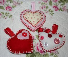 DIY heart ornaments! Love the felt and buttonhole stitch.