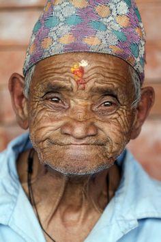 Photo and caption by fukzhe Li  Beautiful smile of an elderly man in Kathmandu old shelter house in Nepal.