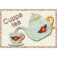 Cuppa Tea Mug Rug | Sweet and fragrant tea really needs to be poured into a delicate china cup, doesn't it? And a mug rug in the style of shabby chic makes it even more charming. So pull out those lovely florals for this little project!