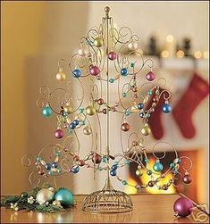 colored wire Christmas tree ornament - Google Search Tabletop Christmas Tree, Christmas Tree Ornaments, Wire, Google Search, Color, Colour, Christmas Tree Toppers, Colors, Xmas Tree Decorations