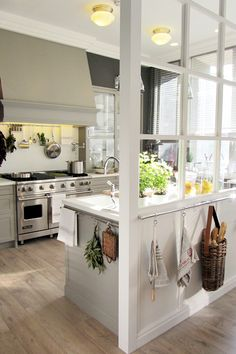 Wall built to look like a window separates the kitchen while keep sight lines open. #kitchen