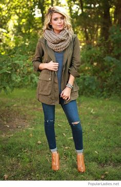 Blue jeans, a simple blouse and an army coat