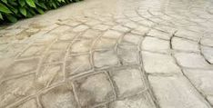 This article will give you a side by side comparison of stamped concrete and interlocking concrete pavers. Concrete Pavers, Stained Concrete, Flagstone, Home Window Repair, Stamped Concrete Patterns, Side By Side Comparison, Concrete Contractor, Backyard Patio, Outdoor Living