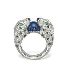 A Diamond, Sapphire, Emerald and Onyx Ring, By Cartier