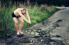 Clever Photos of Potholes That Highlight the Poor State of Roads in Kaunas, Lithuania