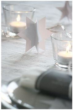 Christmas table setting idea with cut-out stars & Candle Impressions flameless tea lights or votives